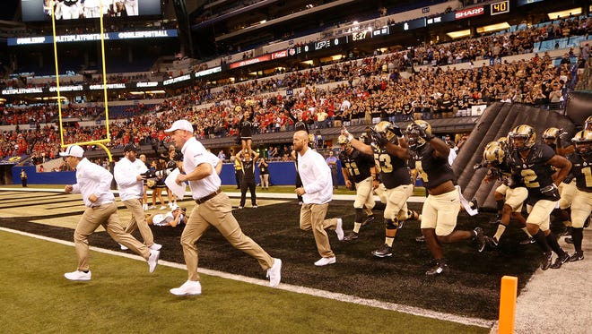 Purdue head coach Jeff Brohm leads the Boilermakers on the field to face Louisville Saturday, September 2, 2017, in Lucas Oil Stadium in Indianapolis.