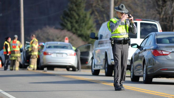 Ohio Highway Patrol documents the scene of a child struck by a vehicle on Ohio 28 near Cameo Lane.