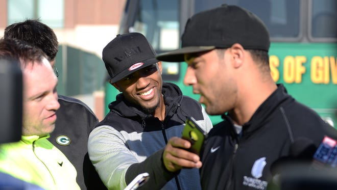 Cornerback Micah Hyde, right, gets pranked by fellow cornerback Casey Hayward, back, pretending to be a reporter as the Packers Tailgate Tour prepares to depart Tuesday from Lambeau Field.