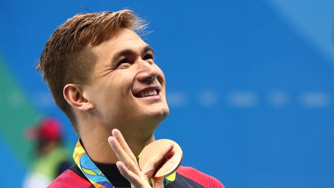 Nathan Adrian (USA) with his bronze medal after the men's 100m freestyle final in the Rio 2016 Summer Olympic Games at Olympic Aquatics Stadium.