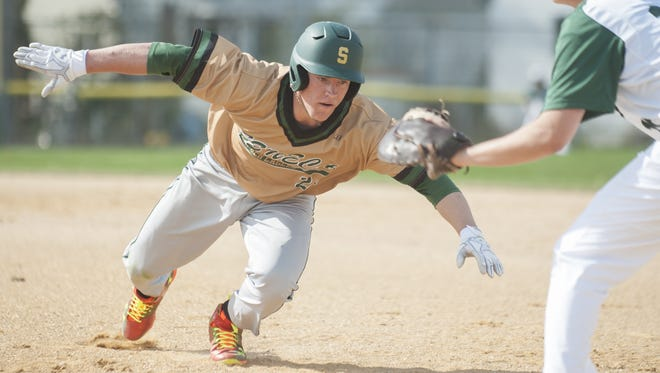 Seneca's Nick Decker dives safely back to first base during a game last season. Decker will play in the Perfect Game All-American Classic in San Diego in August.
