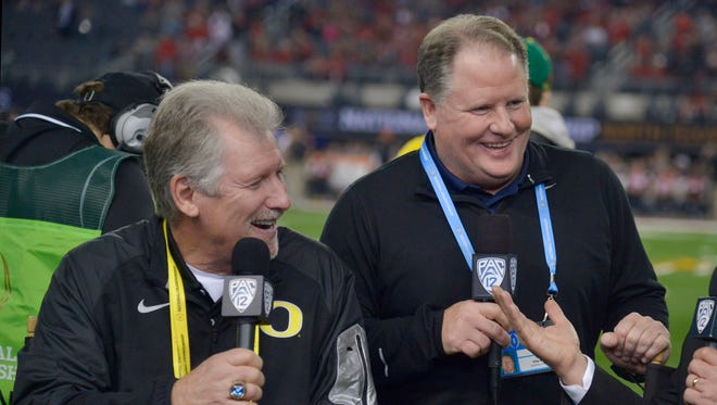 Jan 12, 2015; Arlington, TX, USA; Mike Bellotti  (left) and Chip Kelly (right) are interviewed prior to the 2015 CFP National Championship Game at AT&T Stadium. Mandatory Credit: Kirby Lee-USA TODAY Sports