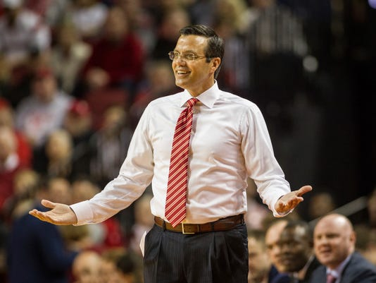 FILE - In this Dec. 16, 2017, file photo, Nebraska head coach Tim Miles reacts to a referee call during the first half of an NCAA college basketball game against Kansas in Lincoln, Neb. Nebraska won 10 more games than it did last season and set a school record for conference victories. Most years that would be reason for celebration in a program with such a dismal basketball history. There was no sense of satisfaction from how things turned out. (AP Photo/John Peterson, File)