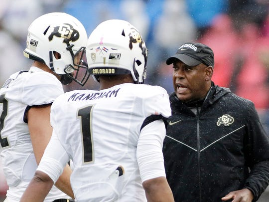 Colorado head coach Mel Tucker, right, speaks with quarterback Steven Montez, left, and running back Jaren Mangham as they come off the field during the first half of an NCAA college football game against Washington State in Pullman, Wash., Saturday, Oct. 19, 2019. (AP Photo/Young Kwak)