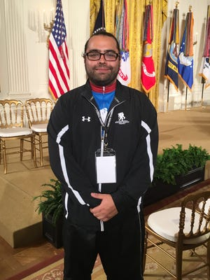 Sal Gonzalez, an Iraq War veteran from Murfreesboro, Tenn., stands in the White House East Room. President Donald Trump honored Gonzalez and other wounded veterans during a White House ceremony on Thursday, April 6, 2017.