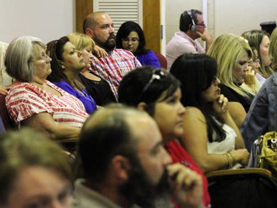 Lafayette Parish citizens attend a school board meeting in 2014. Voters will be asked to approve two new property taxes for the district this year.