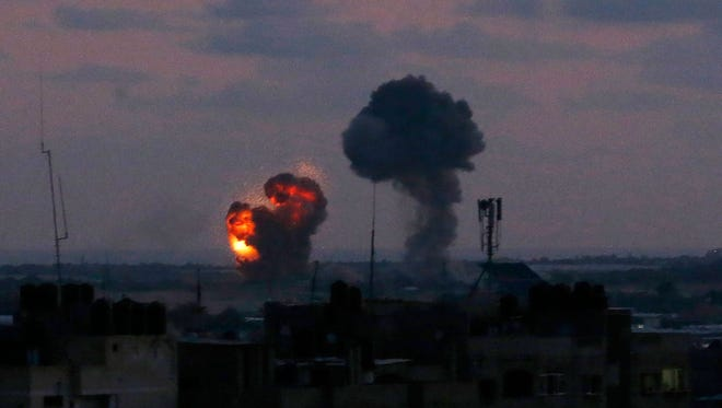 An explosion is seen at Rafah town in the southern Gaza Strip after an airstrike by Israeli forces on June 20, 2018.