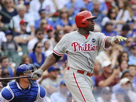Matt Marton-USA TODAY Sports Phillies first baseman Ryan Howard hits a two-run homer in the eighth inning against the Chicago Cubs at Wrigley Field on Sunday. Jul 26, 2015; Chicago, IL, USA; Philadelphia Phillies first baseman Ryan Howard (6) hits a two run homer in the eighth inning against the Chicago Cubs at Wrigley Field. Mandatory Credit: Matt Marton-USA TODAY Sports