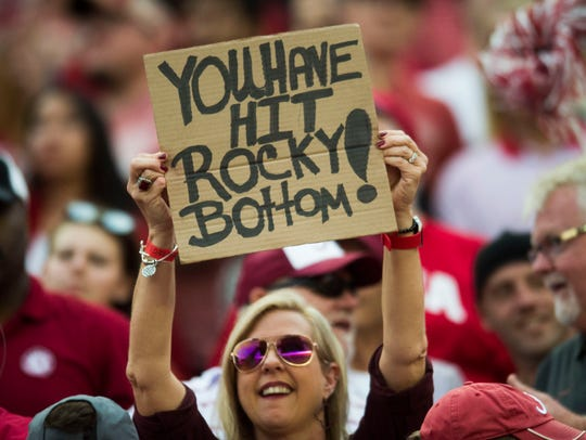 An Alabama fan holds a sign during the Tennessee vs.