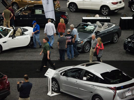 Attendees check out cars at last year's Knox News Auto Show at the Knoxville Convention Center.