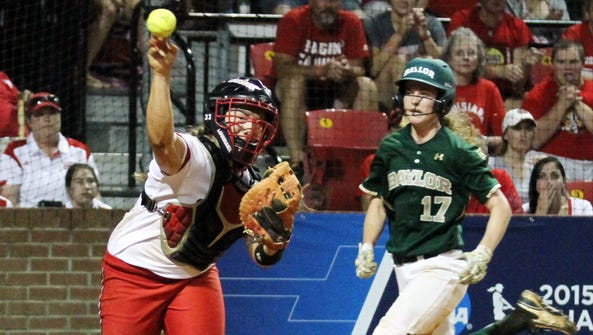 UL catcher Lexie Elkins, shown here turning a double
