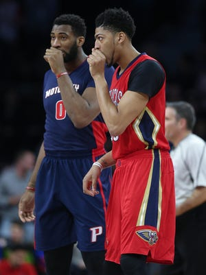 Piston Andre Drummond, left, and Pelican Anthony Davis line up for a jump ball Sunday.