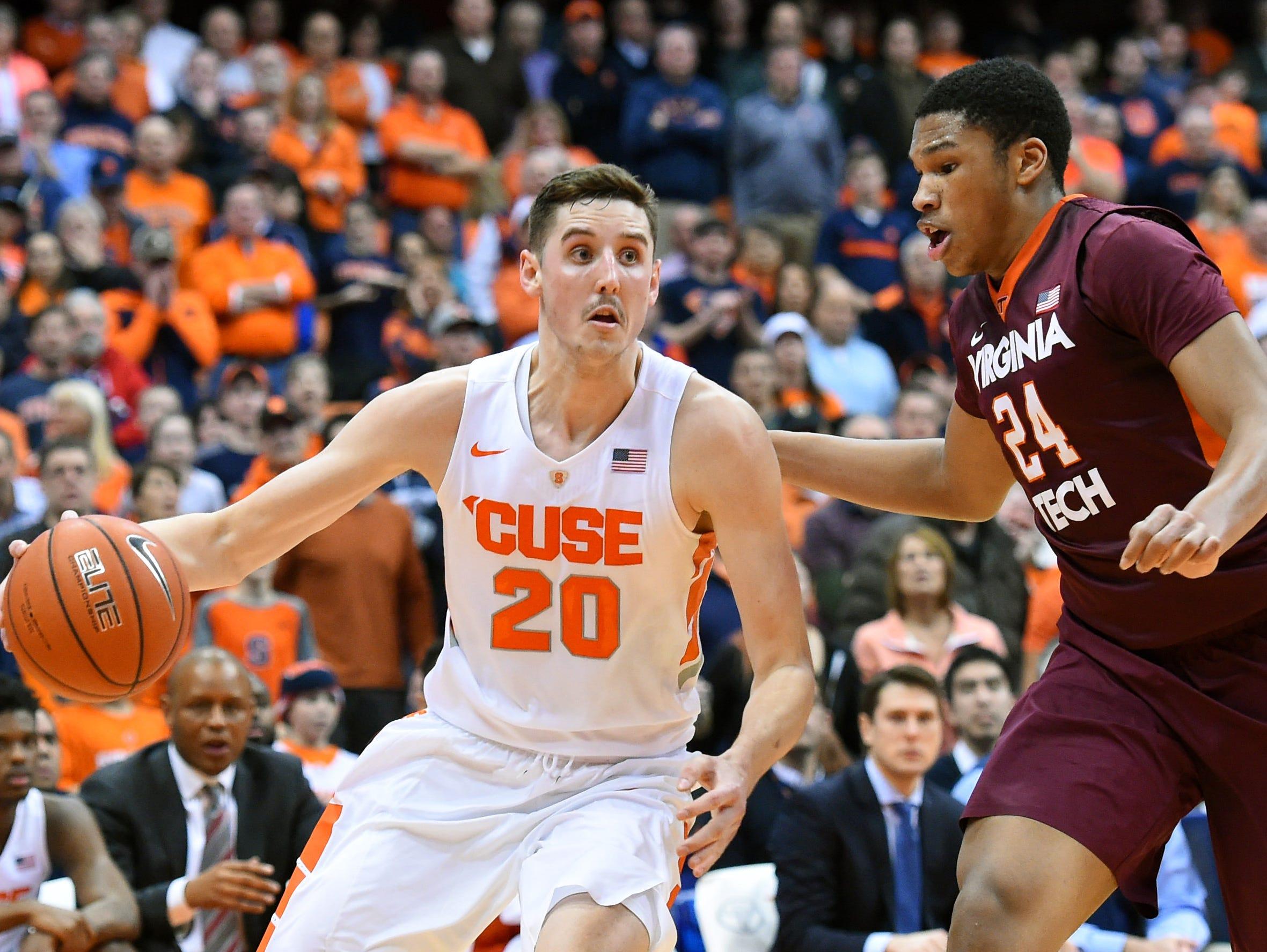 Syracuse's Tyler Lydon tries to dribble past Virginia Tech's Kerry Blackshear Jr. on Feb. 2 in Syracuse.