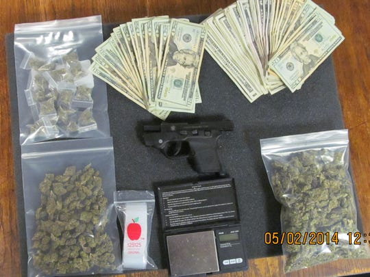 Evidence found at the residence included: marijuana, a .380 caliber semi-automatic handgun, packaging materials, scales and cash.