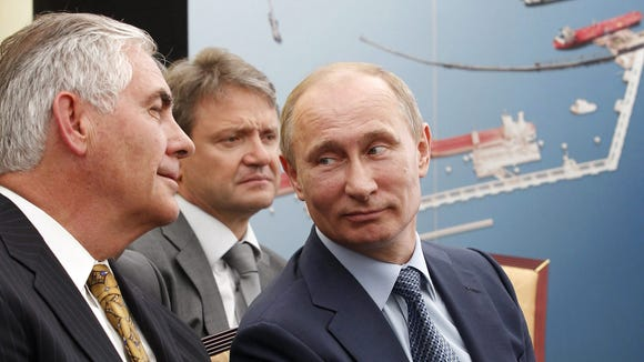 Tillerson and Putin attend a ceremony after the signing