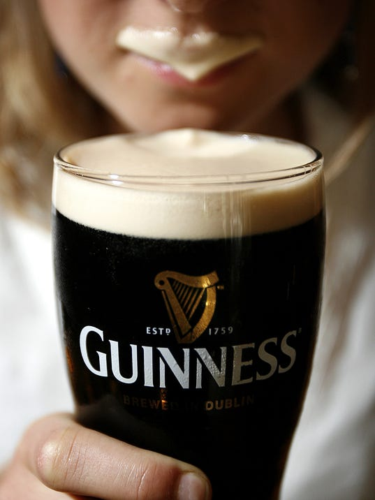 Image result for guinness woman drinking from glass