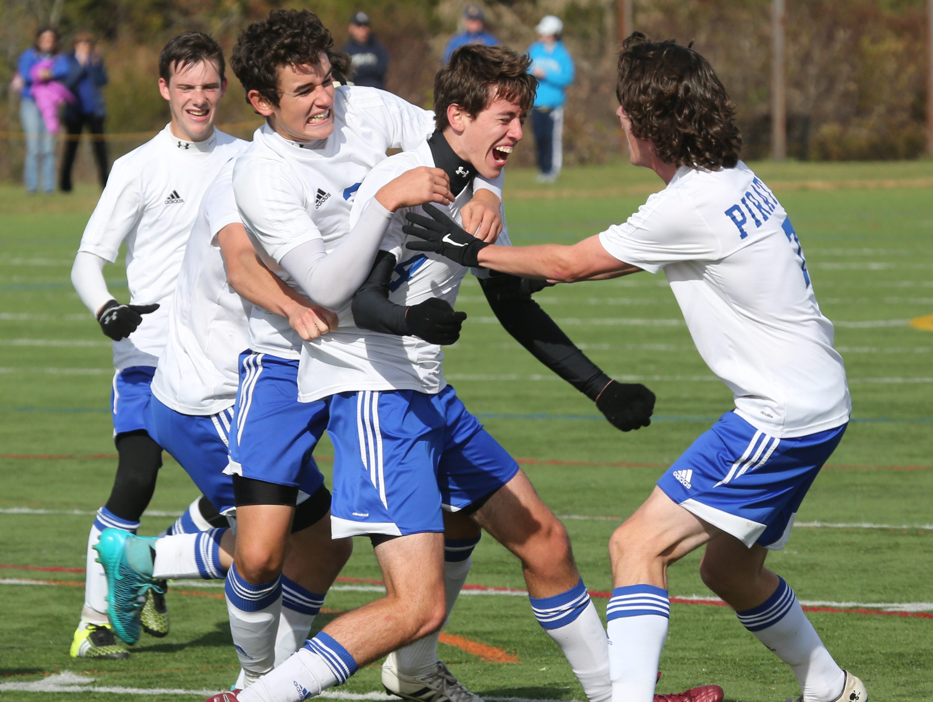 Teammates swarm Pearl River's Ian Haley after scoring a second goal during action in the Section One Class A boys final at Arlington High School, Oct. 31, 2015.