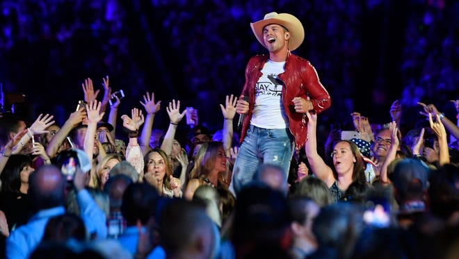 Dustin Lynch performs in the crowd during the CMA Fest at Nissan Stadium Friday, June 9, 2017, in Nashville, Tenn.