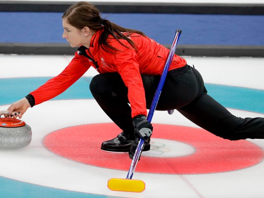 Britain's skip Eve Muirhead throws a stone during a women's curling match against Sweden at the 2018 Winter Olympics in Gangneung, South Korea, Sunday, Feb. 18, 2018. (AP Photo/Natacha Pisarenko)