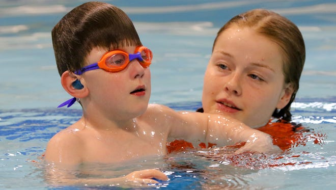 Carter Sobush works with Rachel Koch in an individual lesson at Goldfish Swim School in Brookfield on April 12. Carter's mom signed him up for swim lessons here in December hoping he would gain confidence in the water despite his severe anxiety.