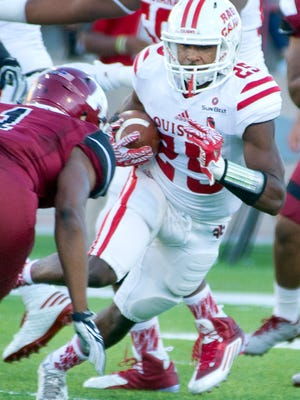 UL running back Raymond Calais Jr. runs before sustaining a quadriceps injury in Saturday night's loss at New Mexico State.