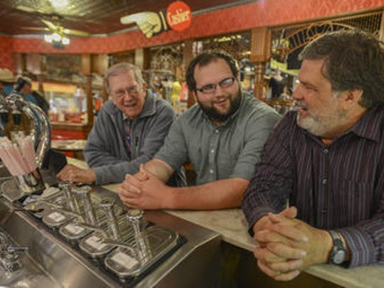 Reggie Smith, Brooks Shaw and T. Clark Shaw (left to right) sit at the ice cream counter at the Old Country Store. The restaurant celebrated its 50 anniversary in 2015.