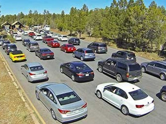 Long lines to enter the South Rim of Grand Canyon National Park are common during summer. Nearly 6 million people visited the canyon last year, a number that can take a toll on facilities.