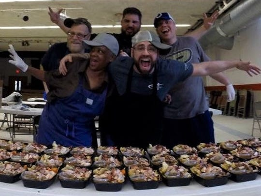 """He's bigger than life,"" Artie's Paleo OnTheGo sous chef chef Colin Kirby, rear middle, said of his boss, mentor and friend chef Artie Stevens, front center. Stevens died Nov. 9, 2017."