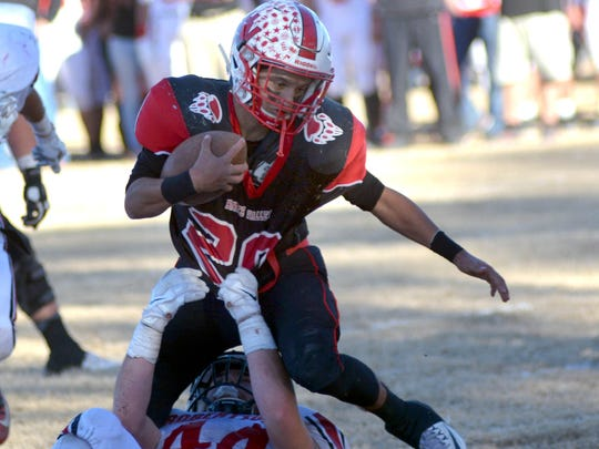 Hatch Valley running back Manny Rodriguez tries to break a tackle just short of the endzone against Las Vegas Robertson.