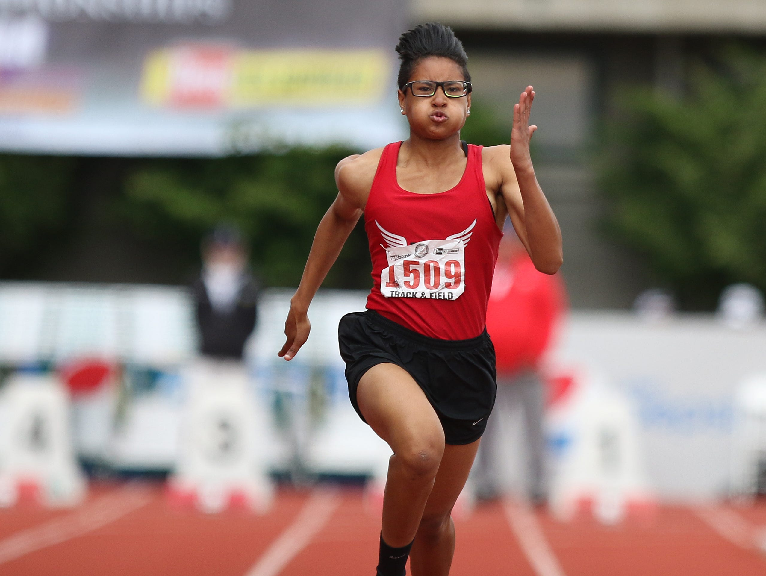 North Salem's Rebekah Miller competes in the 100 meters during the final day of the OSAA Track and Field State Championships at Hayward Field in Eugene, Oregon.