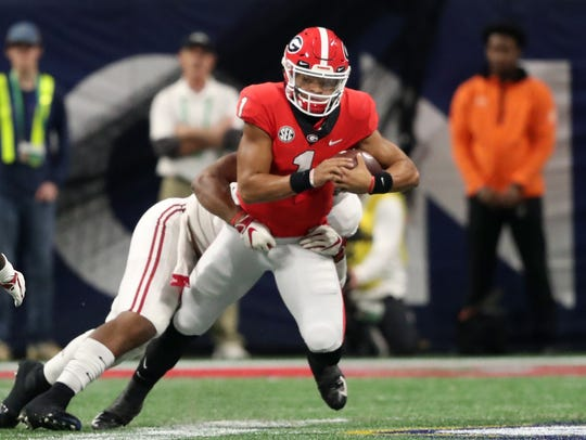 Georgia quarterback Justin Fields runs the ball against