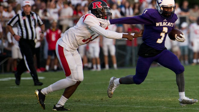 Clarksville High's Joshua Watch runs away from a Rossview player during a game last season.