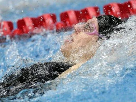 Erin Merkle won the 100 back at the District 3 championships.