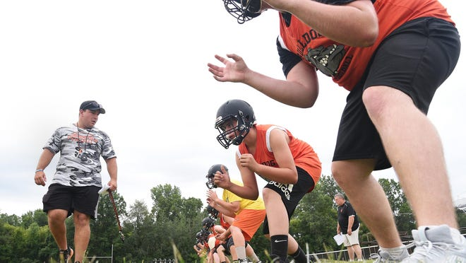 Summerfield football coach Alex Lipka watches his lineman do a drill on the first day of practice last season.