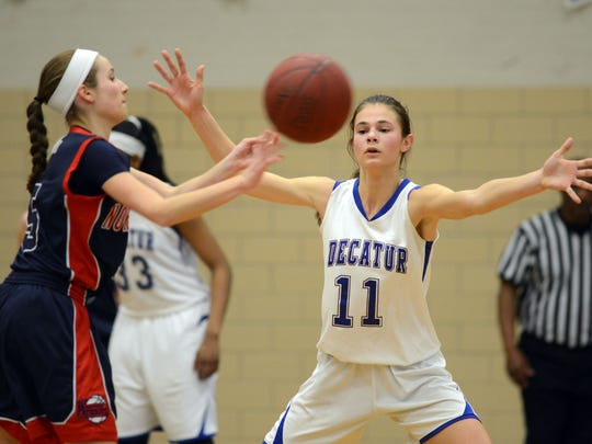 Decatur's Allison Beck tries to break up a pass from