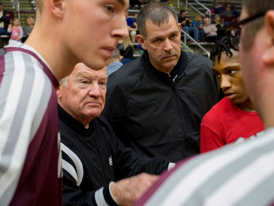 Referees Billy T. Haynes, second left, and Joe Rutledge,