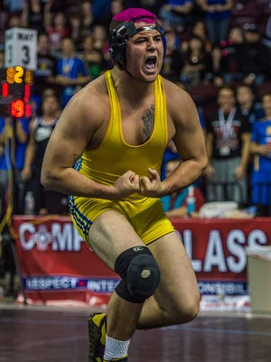 Bloomfield's JD Robinson celebrates after winning the state championship of the 182-pound class on Feb. 21 at the 4A state tournament at the Santa Ana Star Center in Rio Rancho.