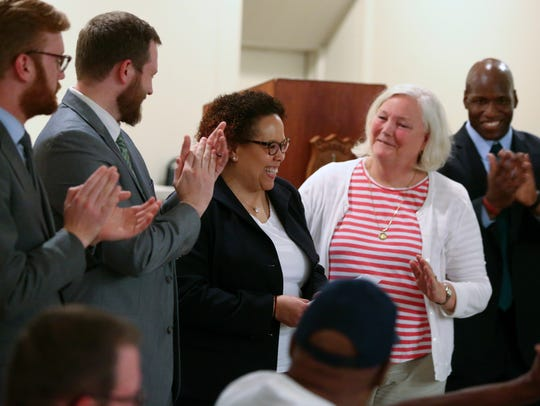 Cassandra Marshall (center) is applauded by other newly