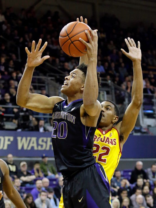 FILE - In this Feb. 1, 2017, file photo, Washington's Markelle Fultz (20) drives to the basket ahead of Southern California's De'Anthony Melton during the first half of an NCAA college basketball game, in Seattle. Fultz is expected to be a top pick at the NBA Draft on Thursday, June 22. (AP Photo/Elaine Thompson, File)