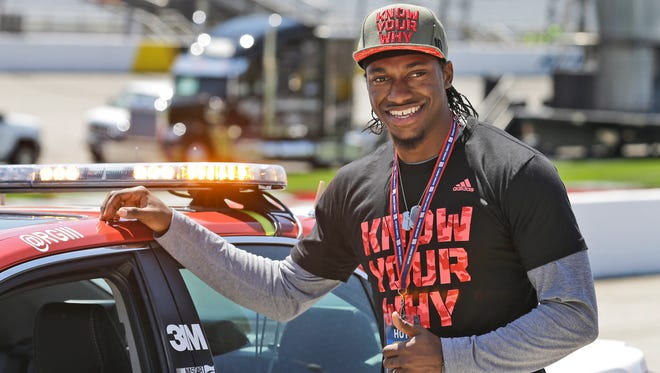 Robert Griffin III poses next to the pace car for Saturday's race in Richmond.