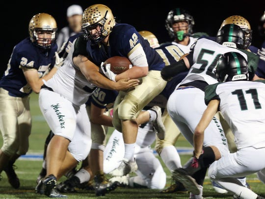 Lourdes' Sean McDowell (42) goes up the middle against