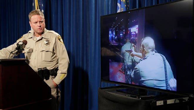 Las Vegas police undersheriff Kevin McMahill shows body-camera footage from officers near where the Michael Bennett incident took place. However, the officers involved in detaining Bennett did not have their cameras activated.