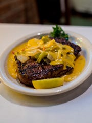 The Don Briggs special, a steak served off-menu, is pictured at La Fonda.