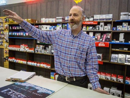 Rick Leiserowitz helps customers at H.B. Leiserowitz