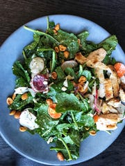 Baby kale salad with chicken at Heritage Food + Drink.