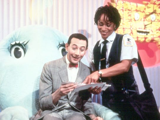 Chairy, left, provides needed support for Pee-wee Herman (Paul Reubens), who gets his mail from Reba (S. Epatha Merkerson).