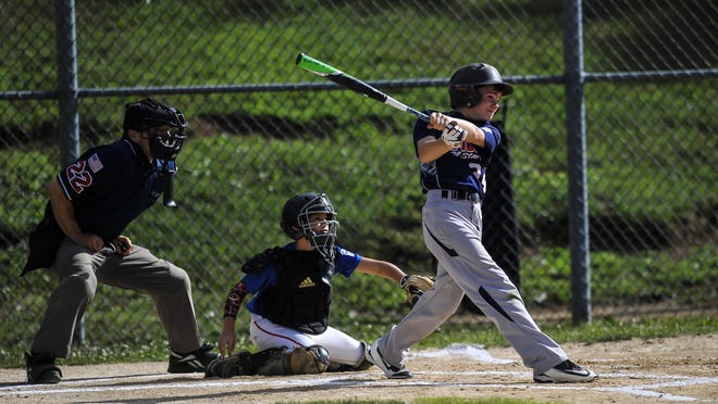 The Tri-Town All-Stars' Ian Kern hits a three run home run in the sixth inning against Randolph during the District 1 Little League baseball game at Freedom Park in Randolph on July 10, 2016.