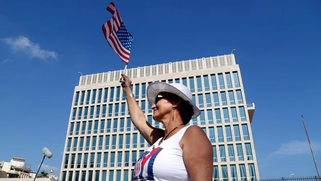 Cuban-American Gina Gonzalez waves an American flag in front of the United States embassy in Havana, Cuba, July 20, 2015.