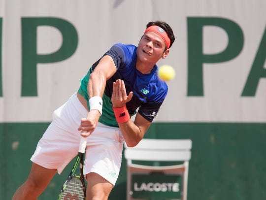 Milos Raonic (CAN) in action against Andrej Martin
