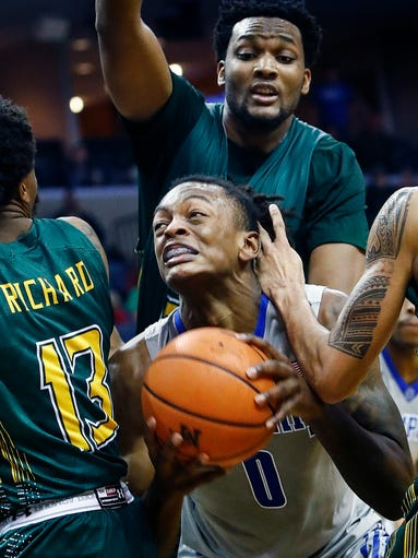 Memphis forward Kyvon Davenport (middle) is fouled